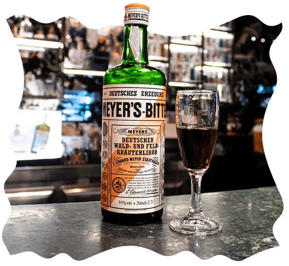 Foto Bar Con Liquore Meyers Bitter Bordo Bianco